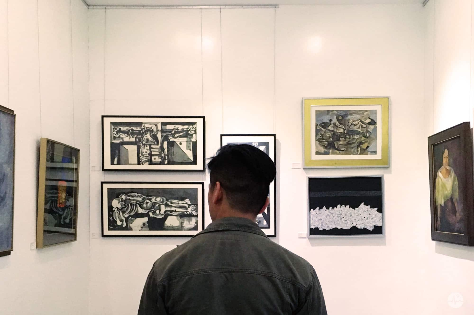 Photo of Paintings on the wall inside Maestro Gallery in BenCab Museum