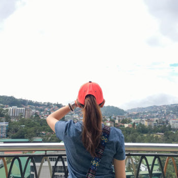 A woman overlooking Baguio City