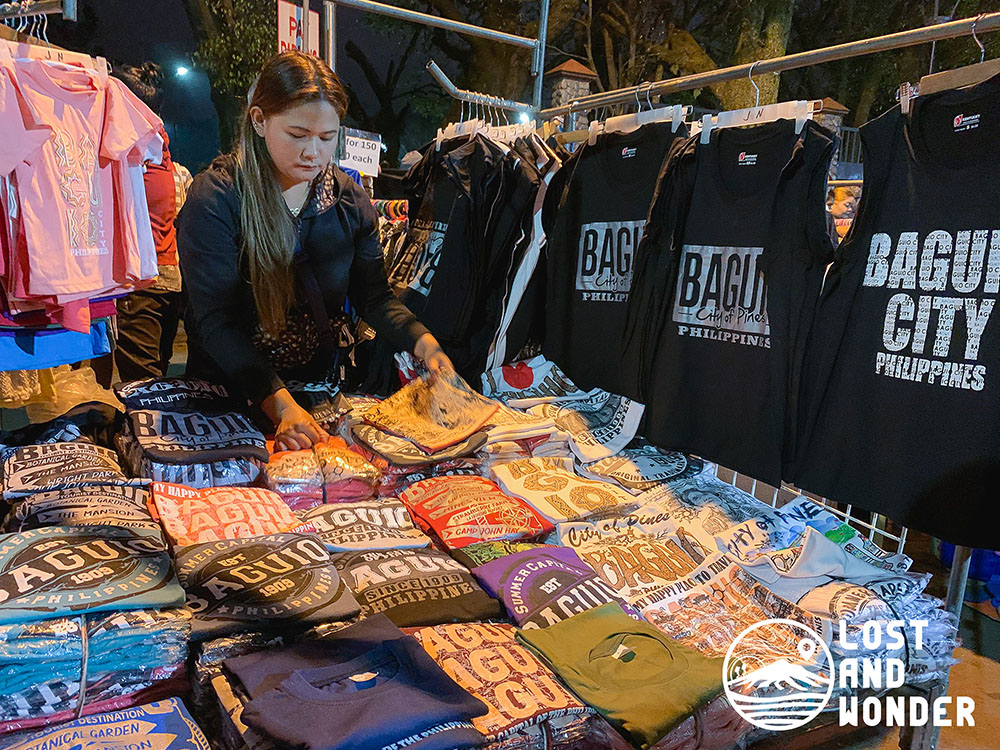 Photo of a woman preparing her store in Night Market