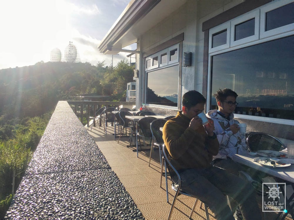 Photo showing the bloggers of Lost and Wonder eating Breakfast in Cafe in the Sky