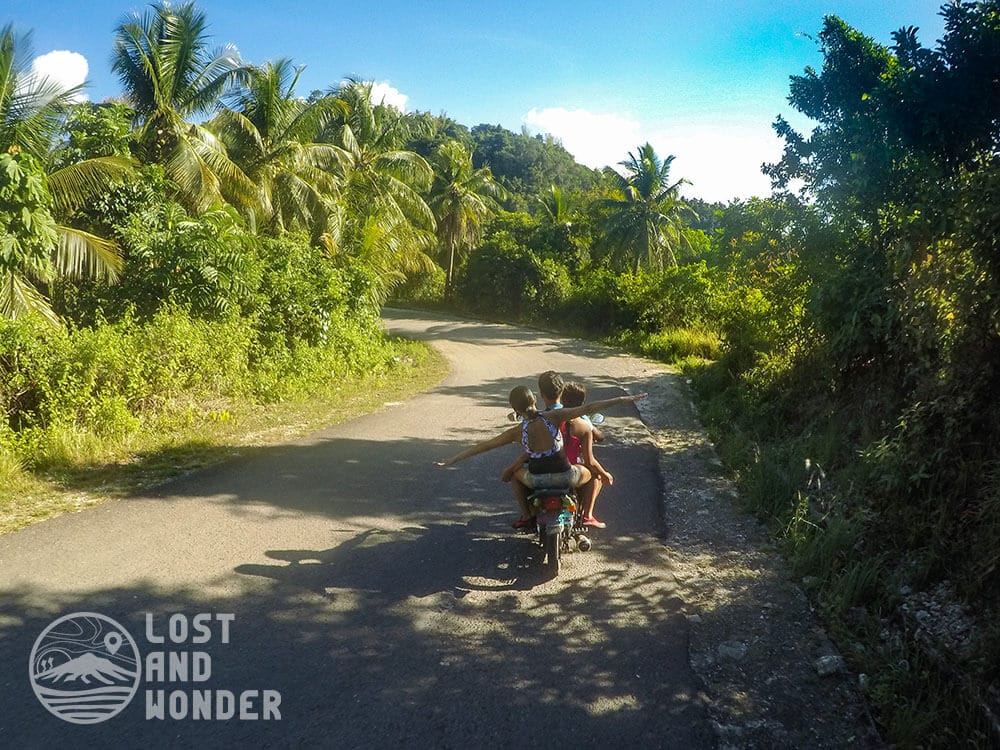 Photo of travelers riding a habal-habal going to Tumalog Falls in Oslob Cebu