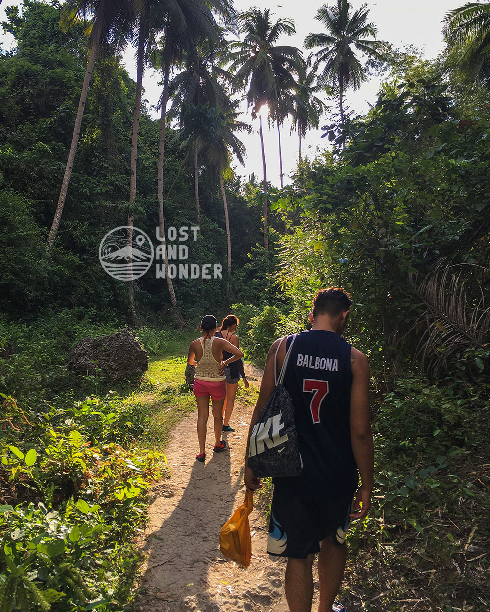 Photo of travelers hiking in Samboan Cebu