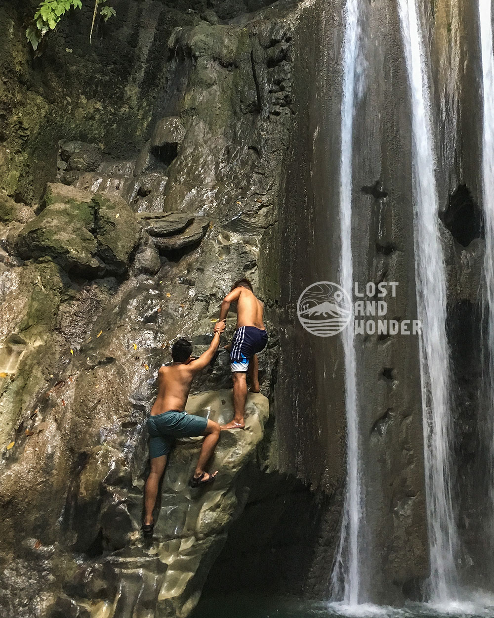 Photo of travelers climbing the Binalayan Falls