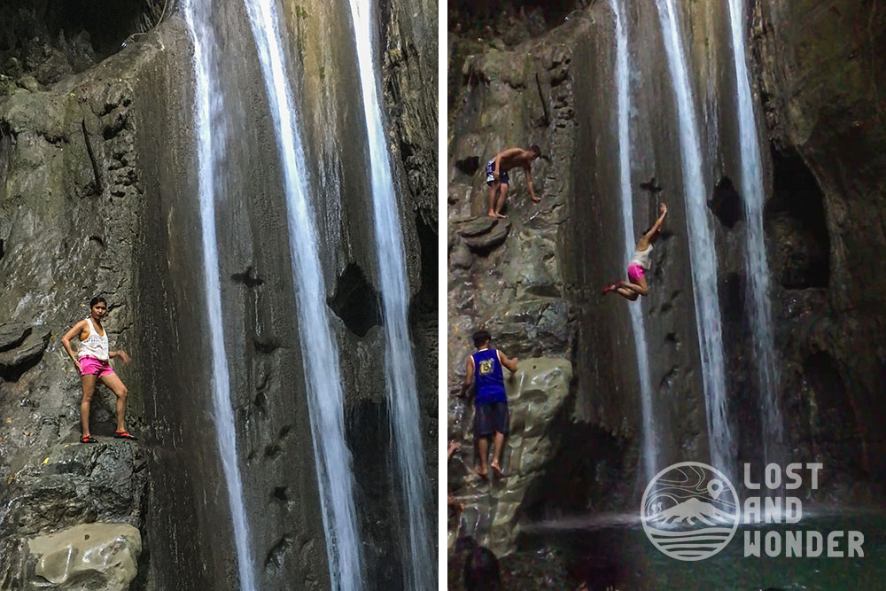 Photo of a woman cliff jumping a waterfall